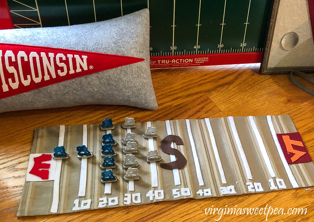 Wisconsin Badgers pennant pillow with handmade football playing field with metal players from Tudor Tru-Action Electric football game