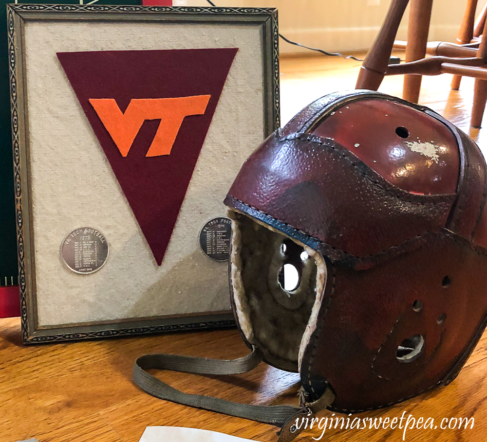 1920s football helmet, VT felt pennant with two coins showing 1973 and 1974 Virginia Tech football schedule