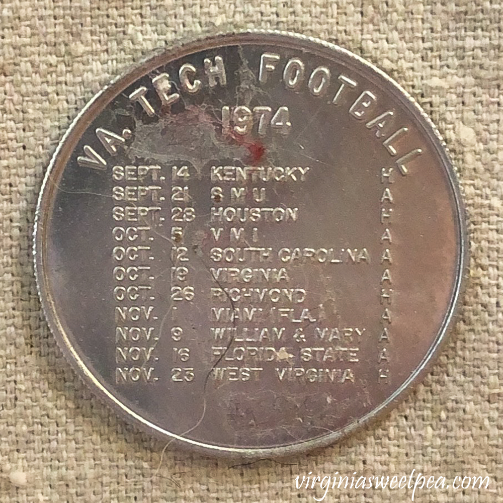 Coin with Virginia Tech football schedule for 1974