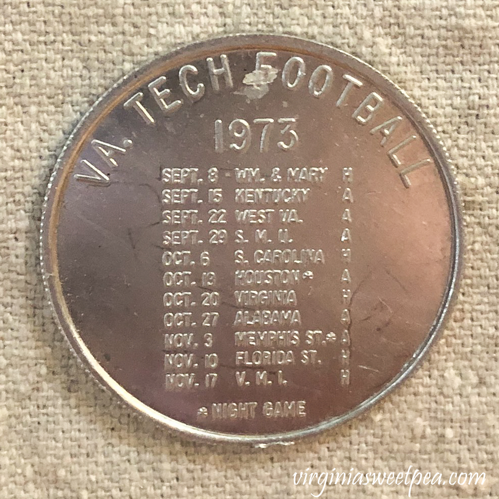 Coin with Virginia Tech football schedule for 1973