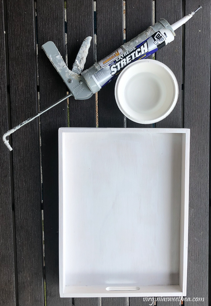 Caulking a wooden tray