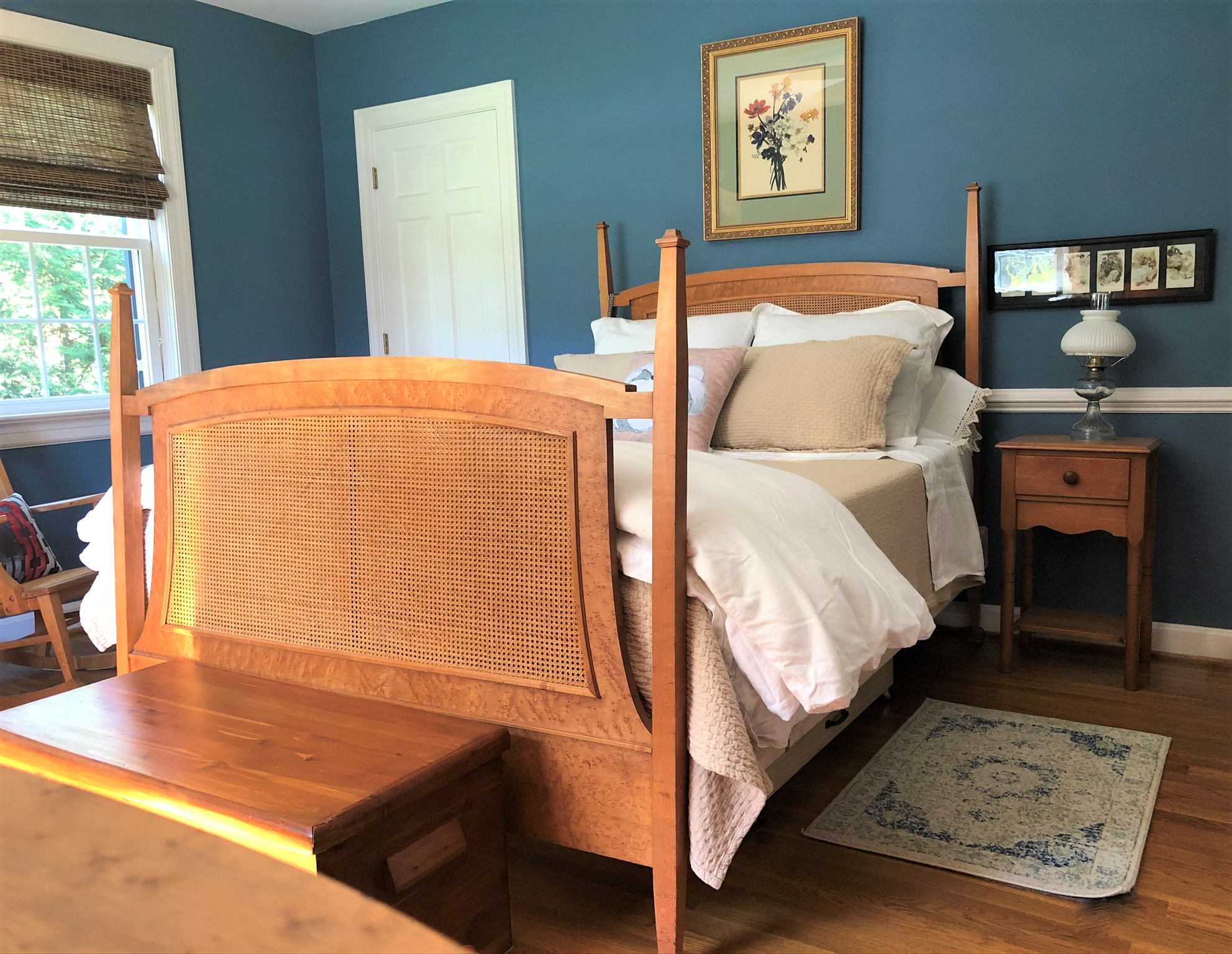 Master bedroom with blue walls and antique Bird's Eye Maple furniture