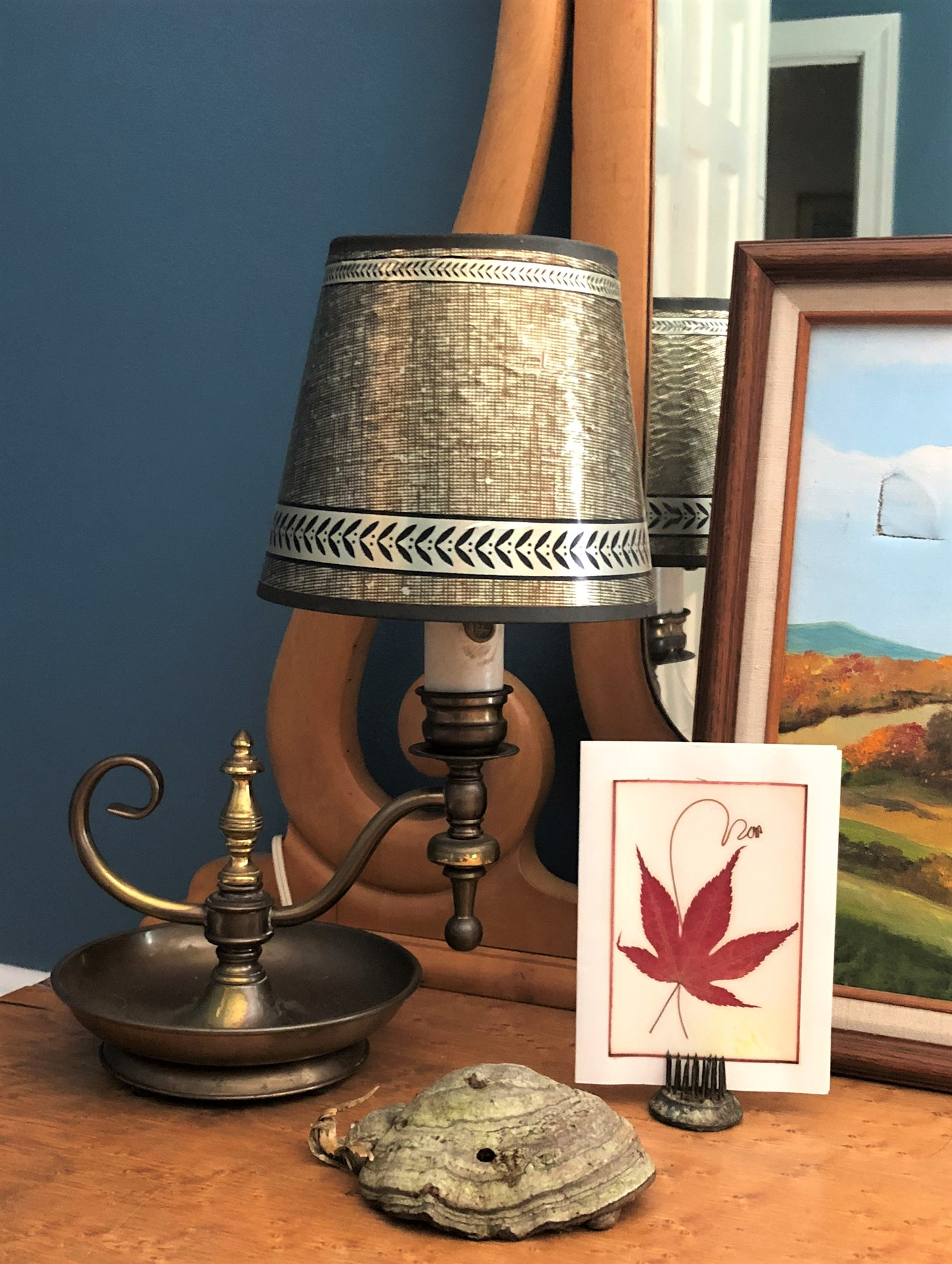 Vintage brass lamp with pressed maple leaf and dried shelf fungus