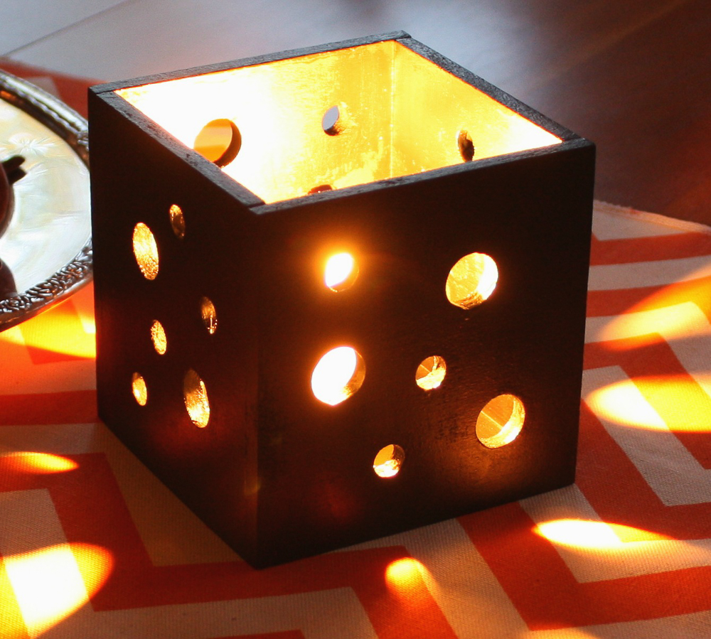 Box shaped Candle holder with holes in the sides