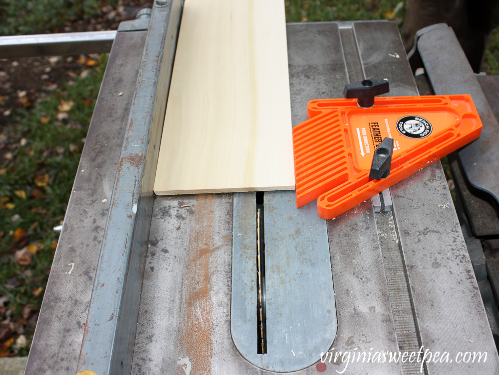 Using a table saw to cut a piece of wood to size