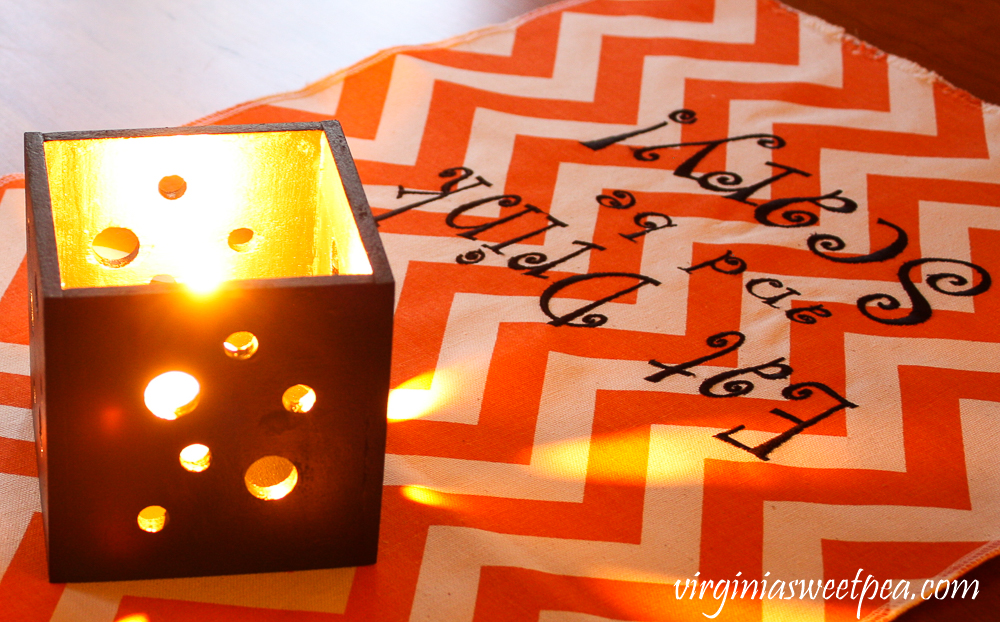 Eat Drink and Be Scary Chevron table runner with black candleholder with holes to let light shine through