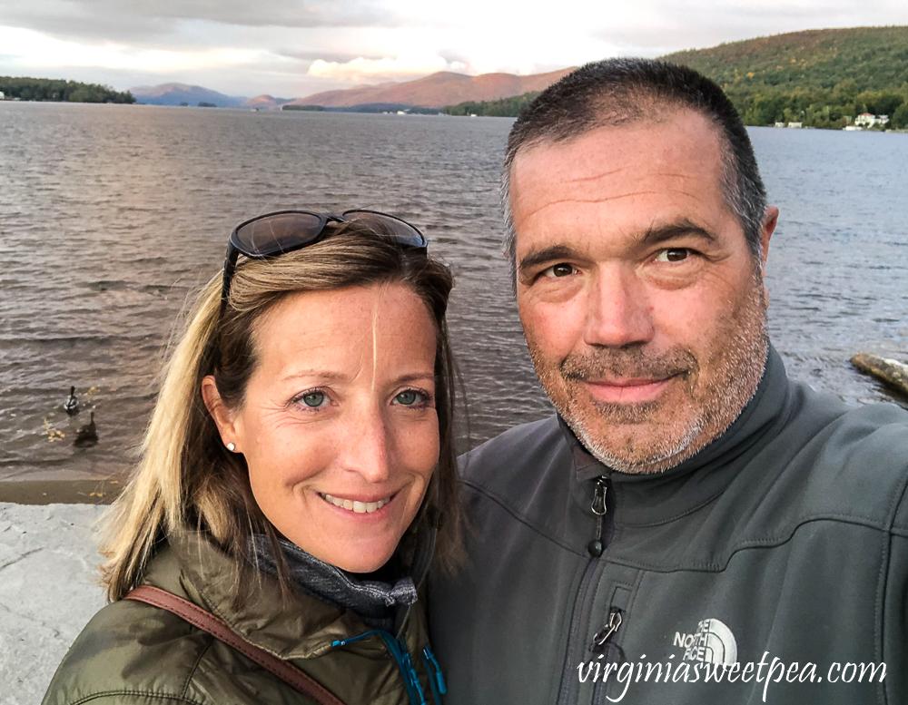 A couple enjoying Lake George, NY on a fall evening