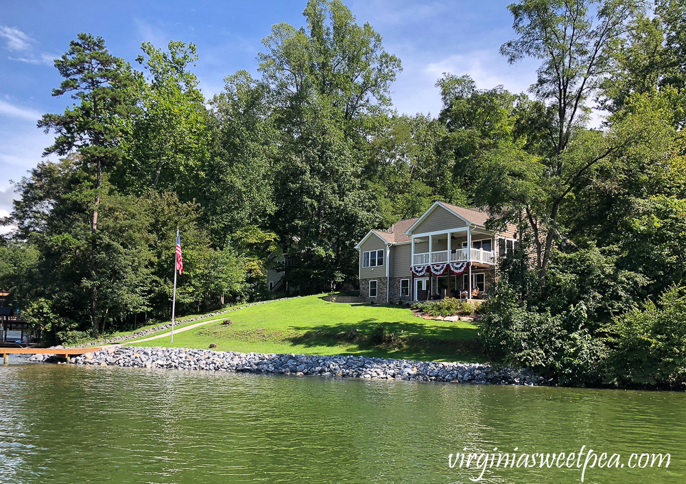 Smith Mountain Lake, VA home with riprap shoreline and flagpole with American flag