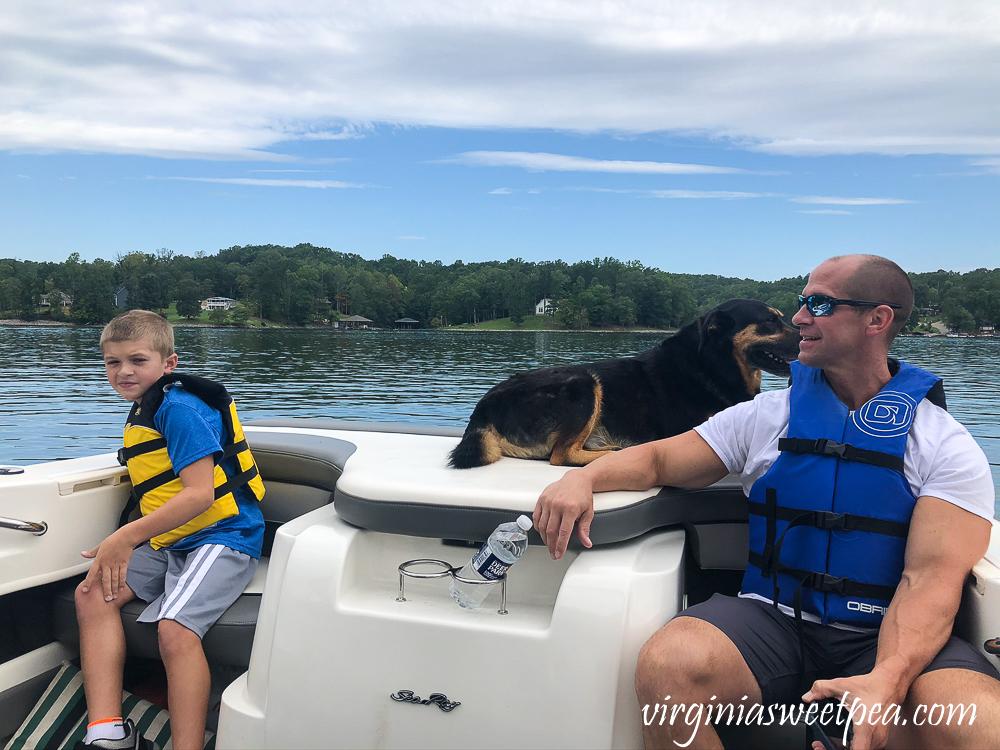 Dad, son, dog on a boat at Smith Mountain Lake, VA