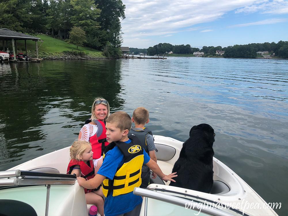 Mom, kids, dog on a boat at Smith Mountain Lake, VA