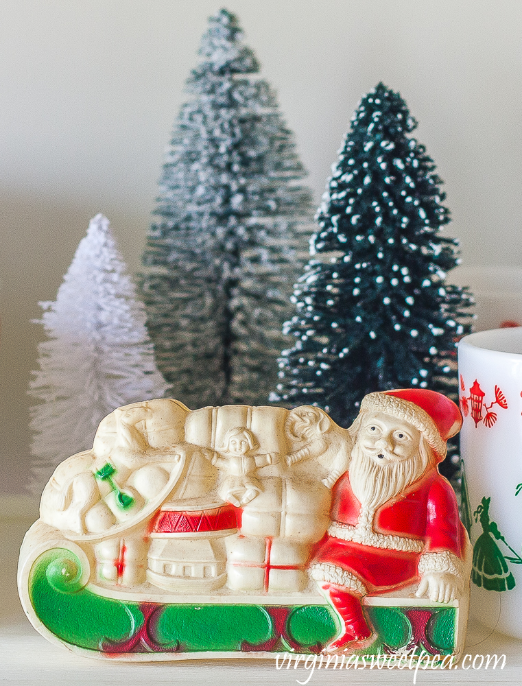 Vintage celluloid Santa with bottlebrush trees