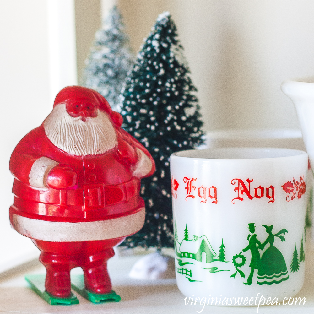 Vintage Santa candy holder with bottlebrush trees and an eggnog cup