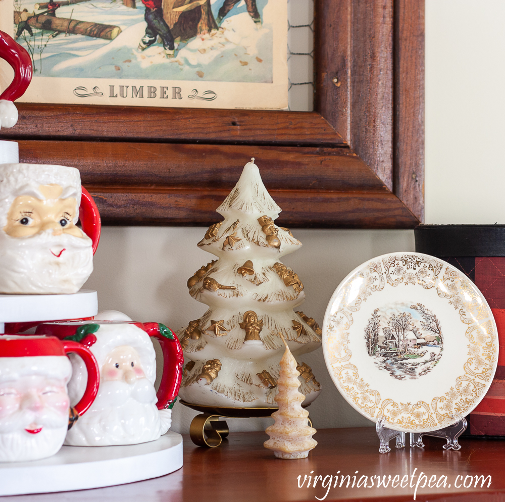 Vintage Santa mugs with vintage Christmas candles and a Knowles plate