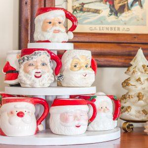 Santa mugs displayed on a three level display stand