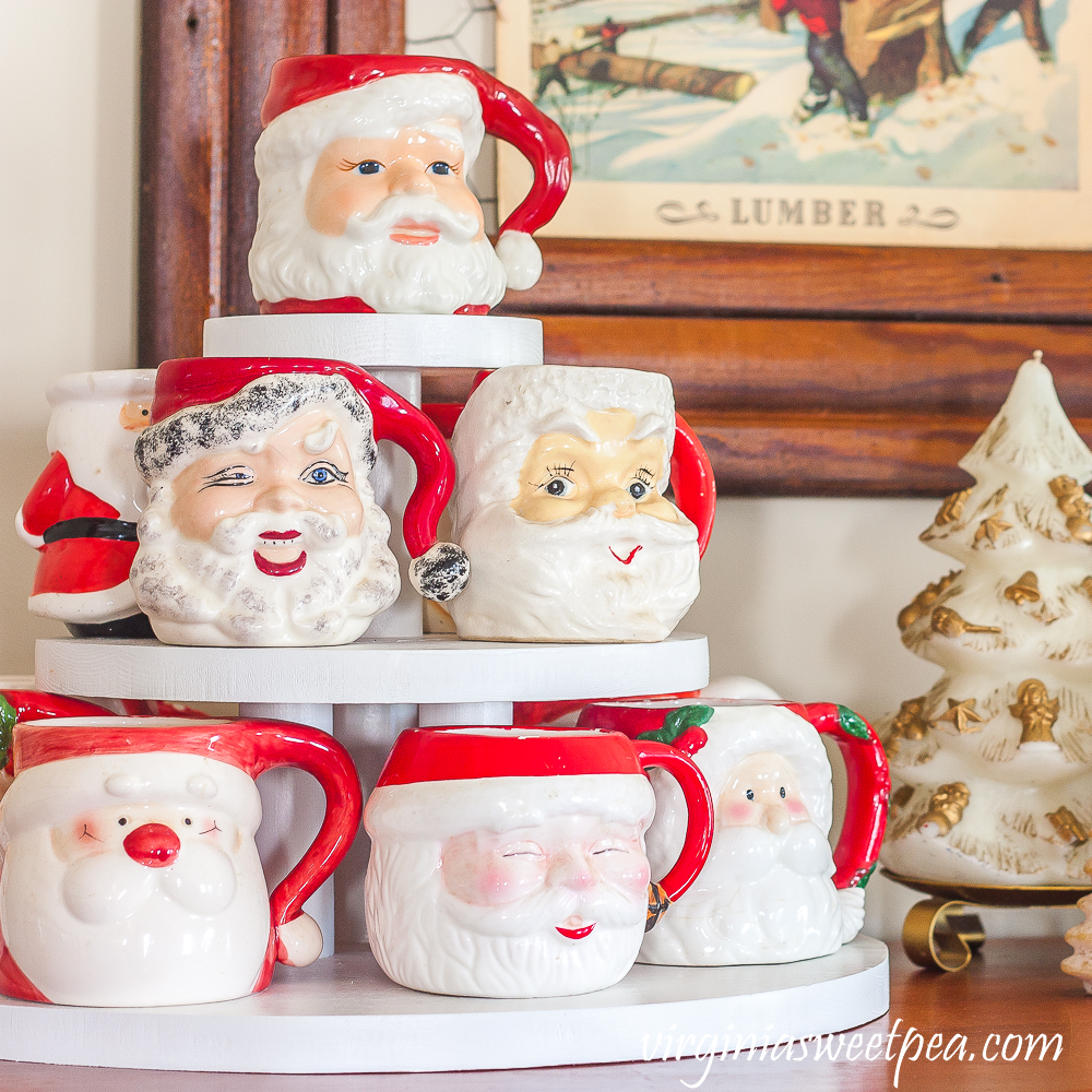 Santa mugs displayed on a three level display stand