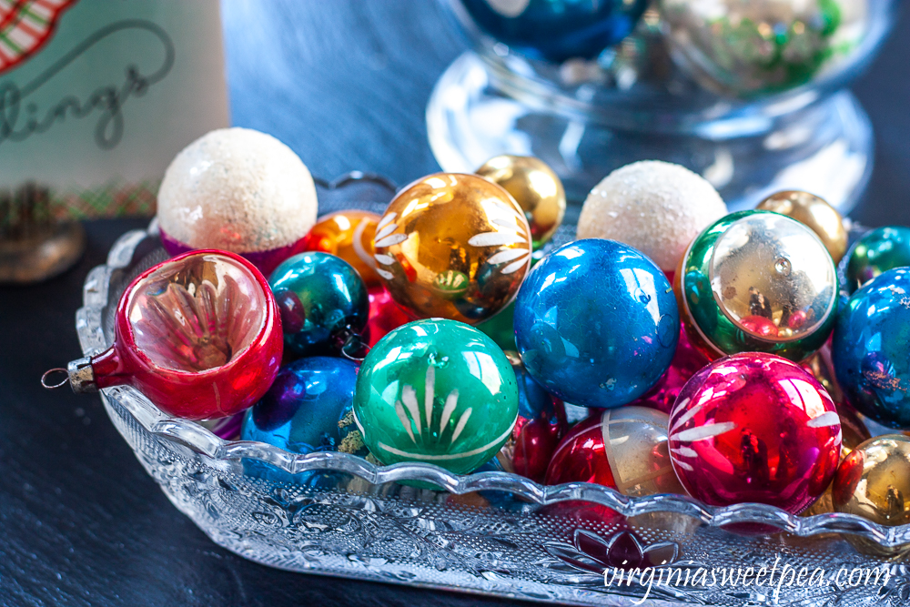 Vintage Christmas balls in an antique glass celery dish