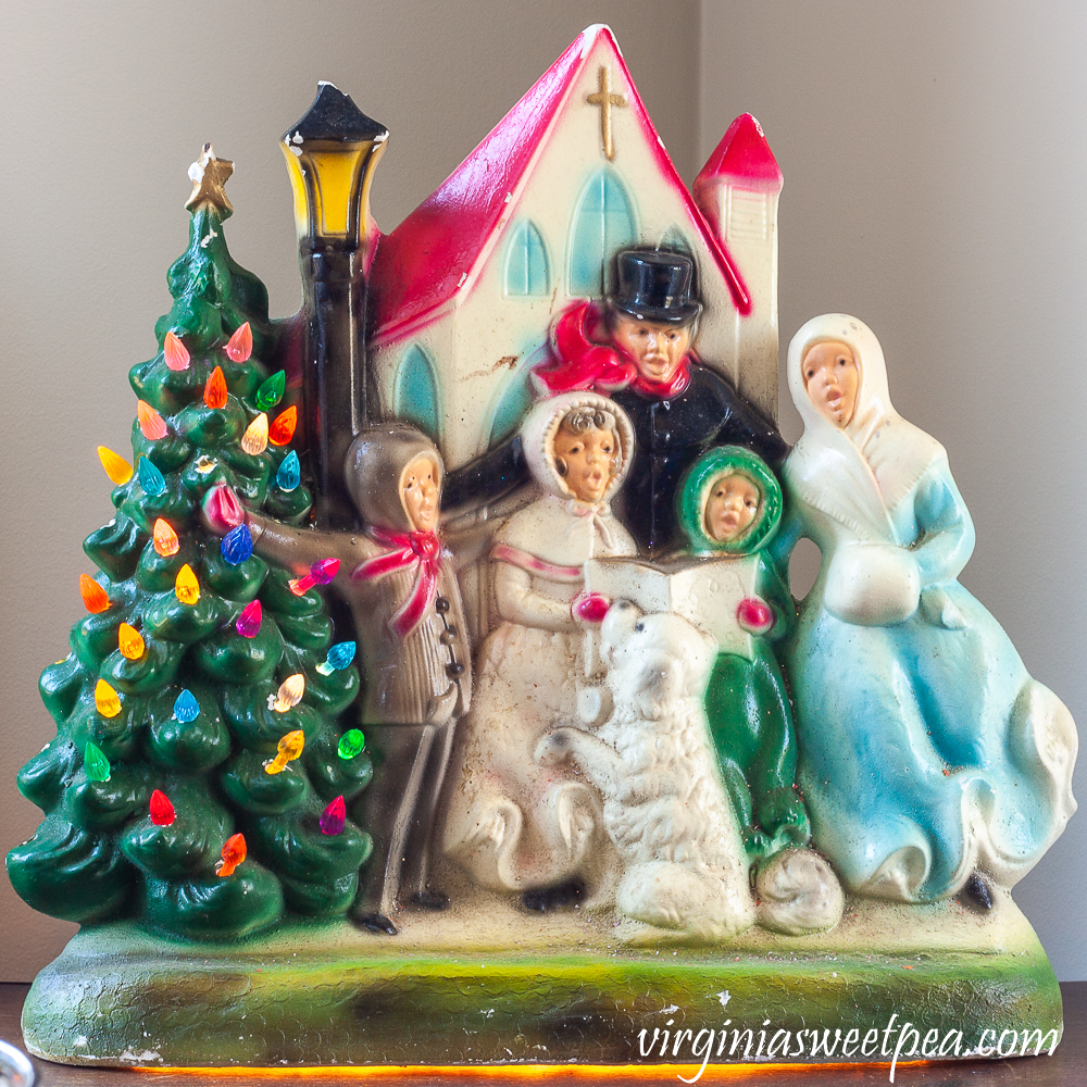 Vintage ceramic carolers with church with tree that lights up.