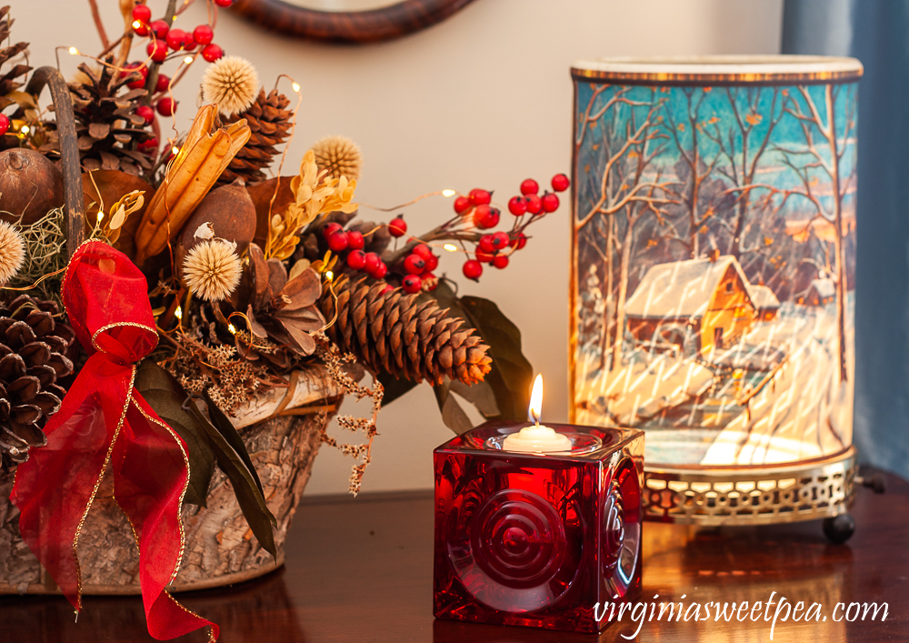 Vintage Econolite motion lamp, red Blenko glass candle holder, and birch bark basket with dried natural elements