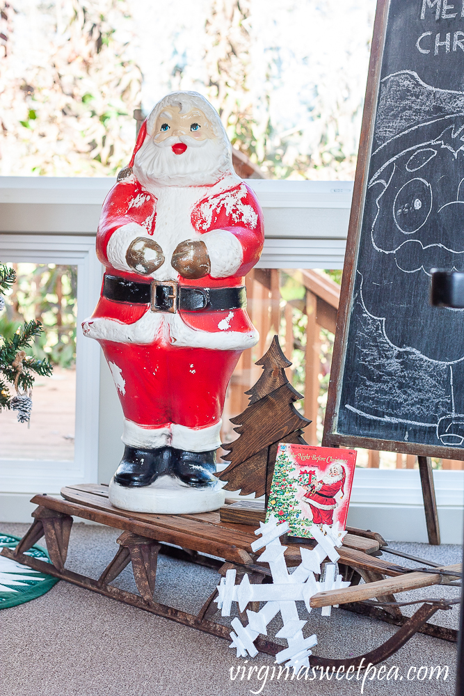 Vintage Blow Mold Santa with wood sled from the 1970s