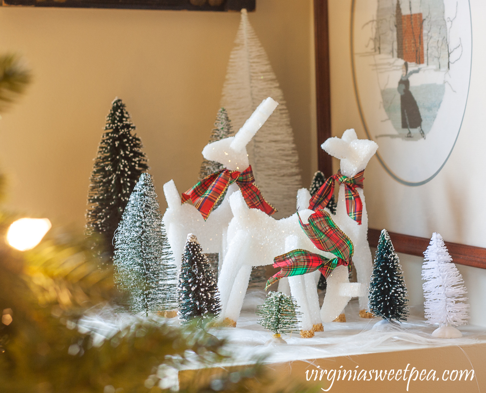 Three styrofoam reindeer with plaid bows