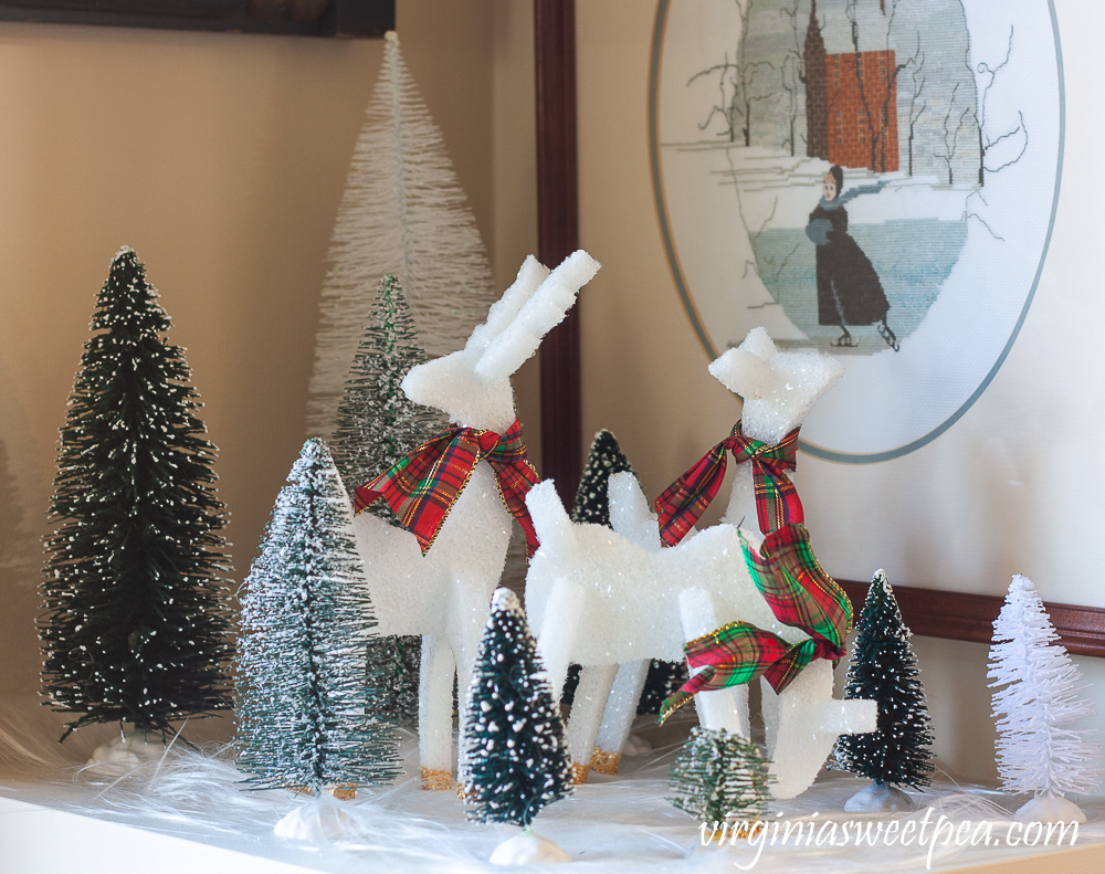 Three styrofoam reindeer with bottle brush trees