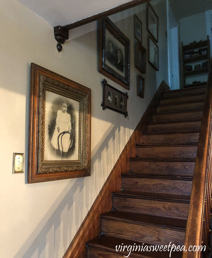 Antique Framed Family Pictures on a Stairwell