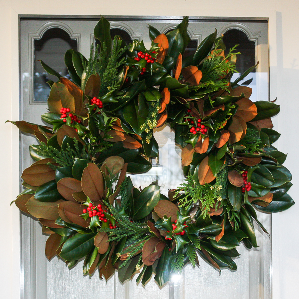Handmade Magnolia wreath with two evergreen varieties and holly added