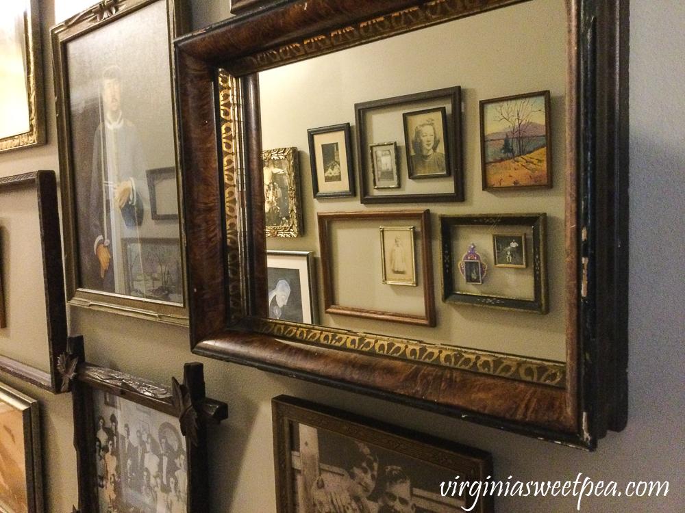 Frames lining a hallway's walls