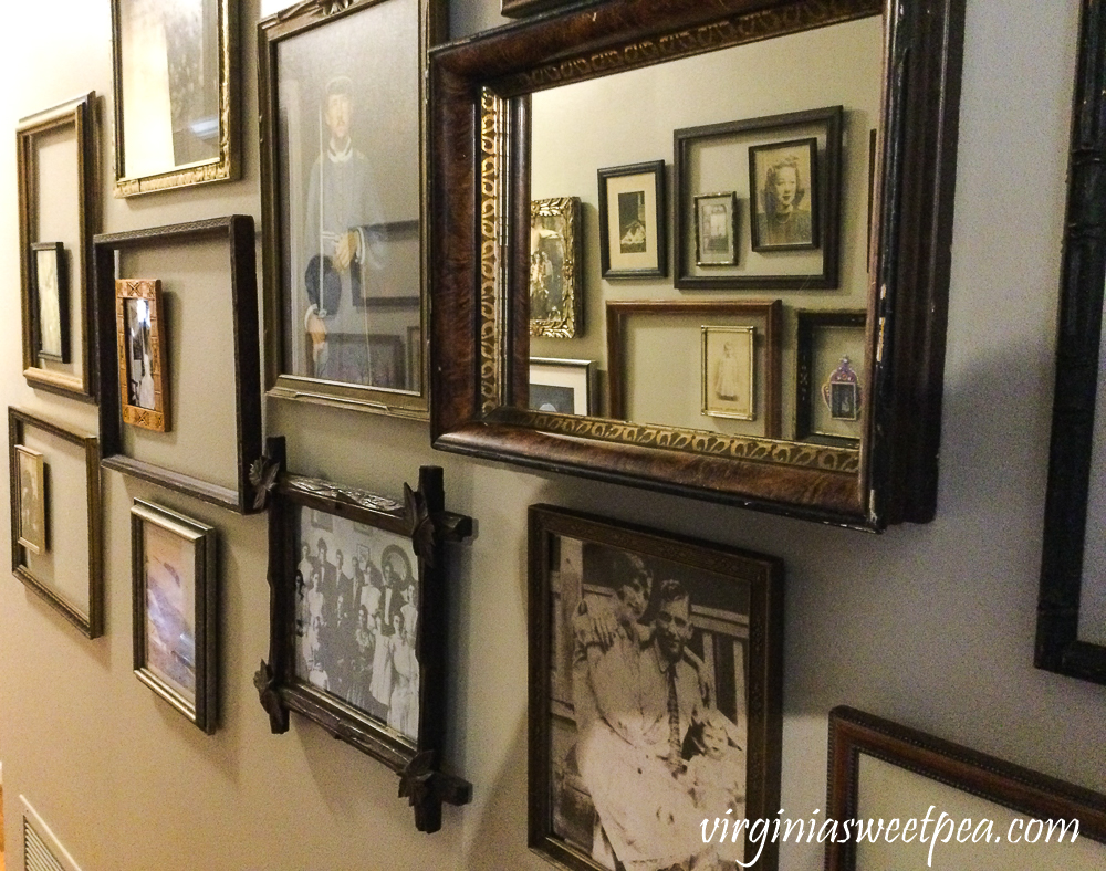 Collection of vintage frames lining the walls of a hallway