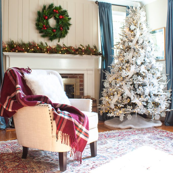 Living room decorated for Christmas with a flocked Christmas tree