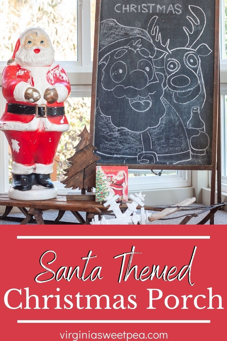 A porch is decorated with vintage Santas for Christmas.  Santa blow molds, Santa boots, Santa candy holders, and Santa candles are some of the items used to decorate this charming porch for the Christmas season. via @spaula