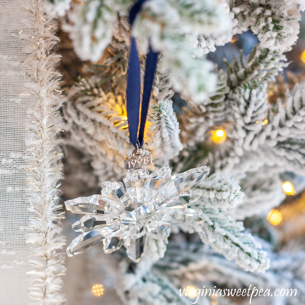 1998 Swarovski snowflake ornament on a tree decorated with a snowflake theme