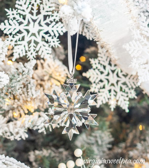 2018 Swarovski crystal snowflake ornament on a Christmas tree decorated with a snowflake theme