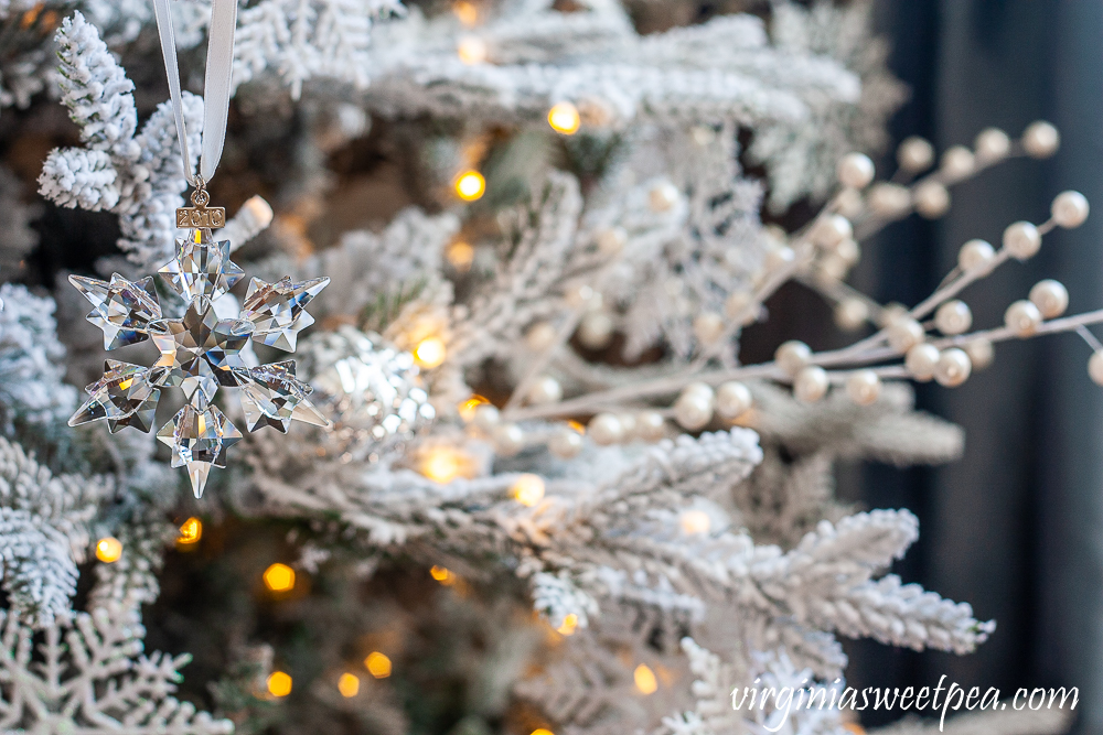 2010 Swarovski crystal snowflake ornament on a flocked Christmas tree