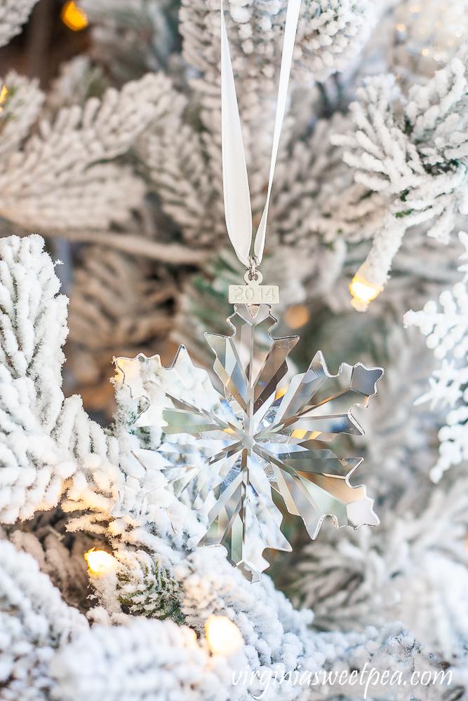 2014 Swarovski snowflake ornament on a flocked Christmas tree