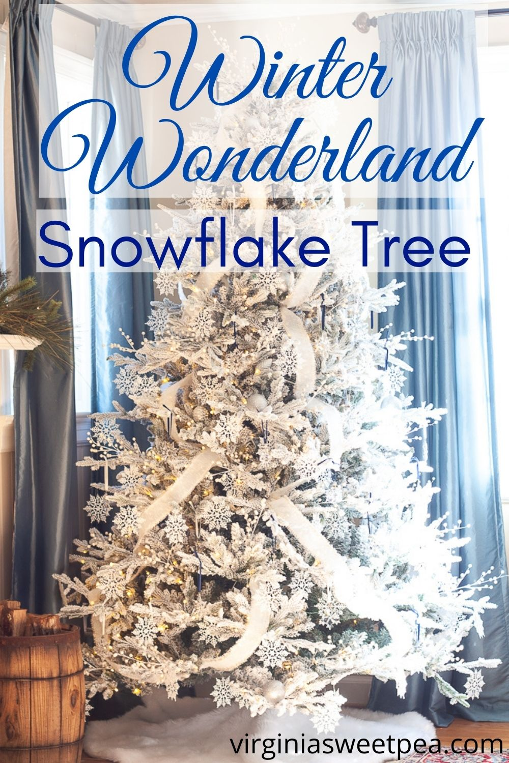 Winter Wonderland Snowflake Tree - Get ideas for decorating a tree with a snowflake theme.  This flocked tree is decorated with dozens of white snowflakes and 26 Swarovski crystal snowflake ornaments.  Get 25+ more Christmas tree decorating ideas from a talented group of home decor bloggers who also are sharing their Christmas trees. via @spaula