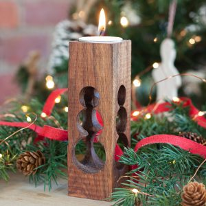 DIY wooden candle holder with a snowman cut into the wood