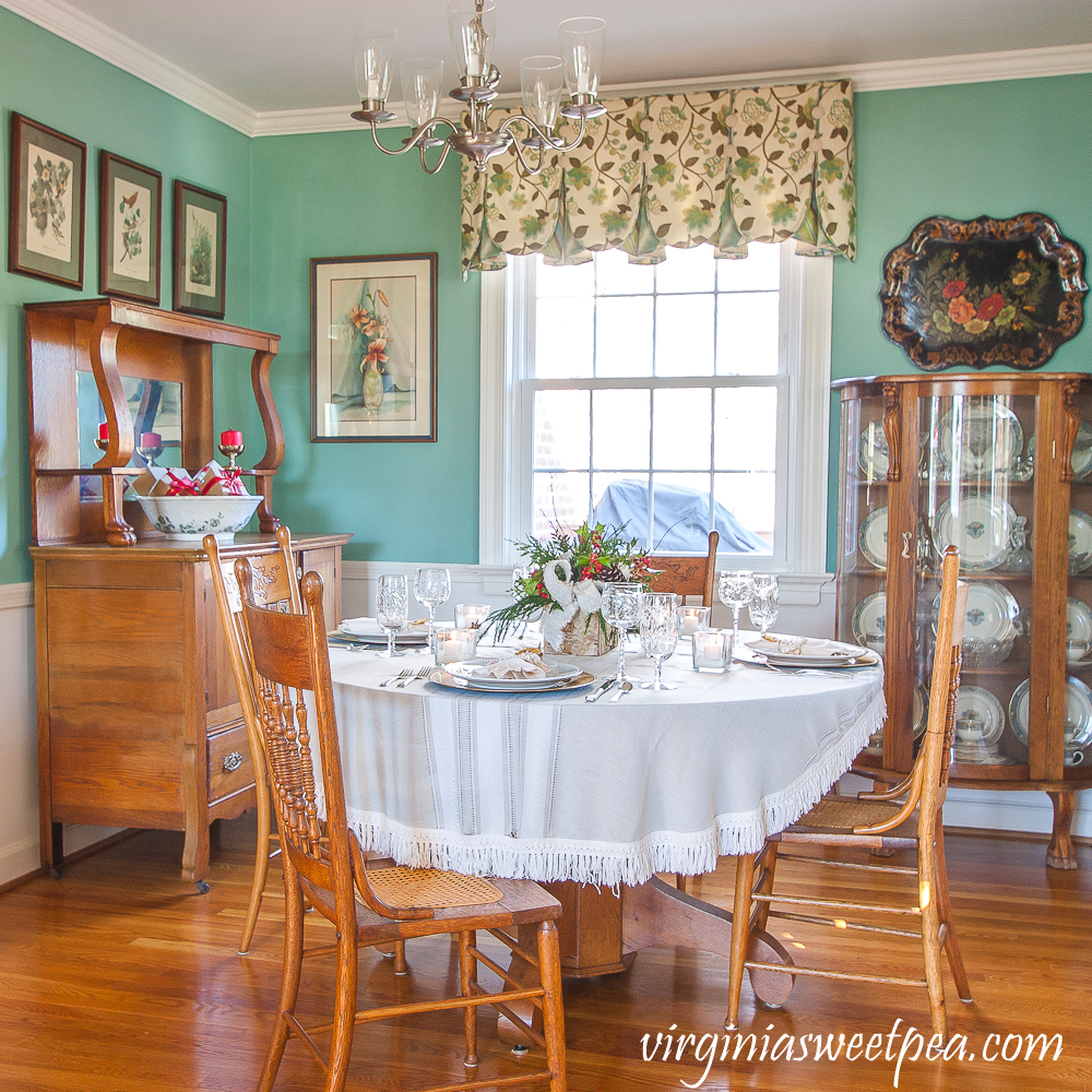 Dining room decorated for Christmas with a Christmas tablescape