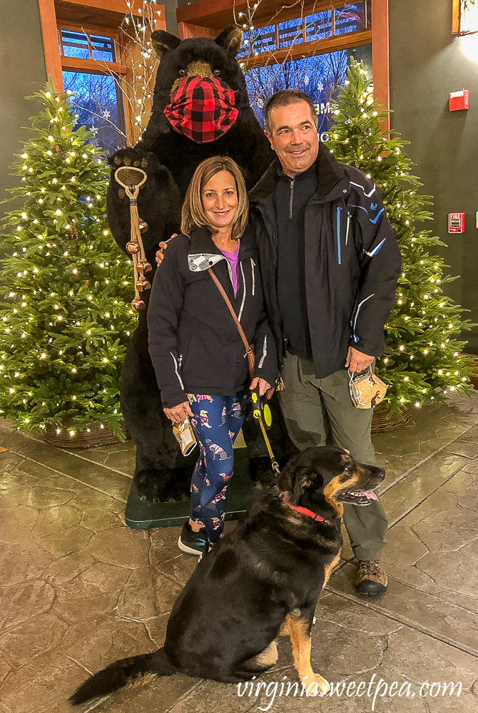 Family photo in front of a bear at Orvis in Manchester, Vermont