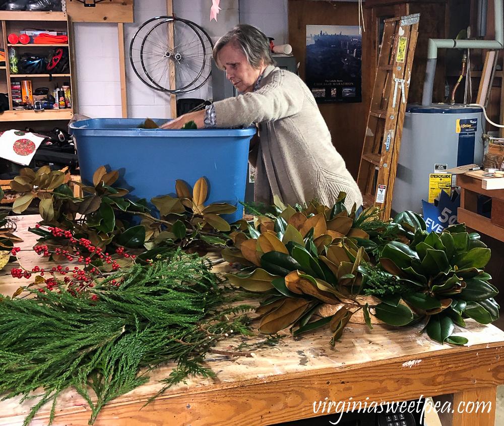 Making a Magnolia wreath in a basement