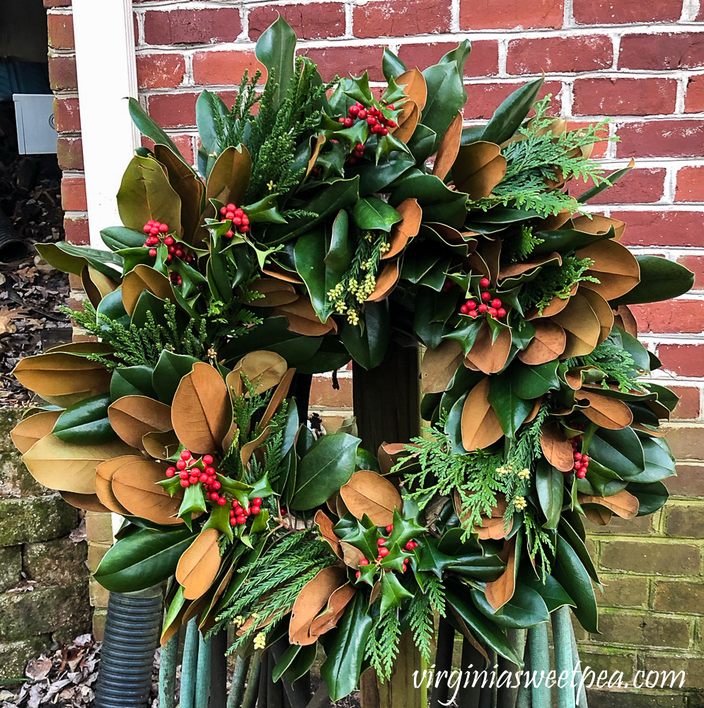 Handmade Magnolia with with Holly and extra evergreens