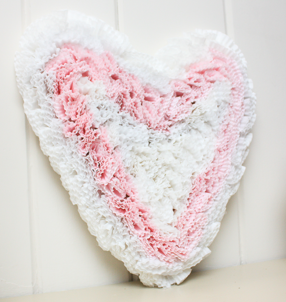 Valentine's Day heart decor made with pink and white cupcake liners.