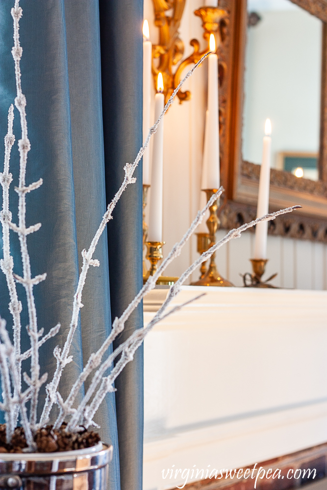 Winter decorating with candles and frosted branches.