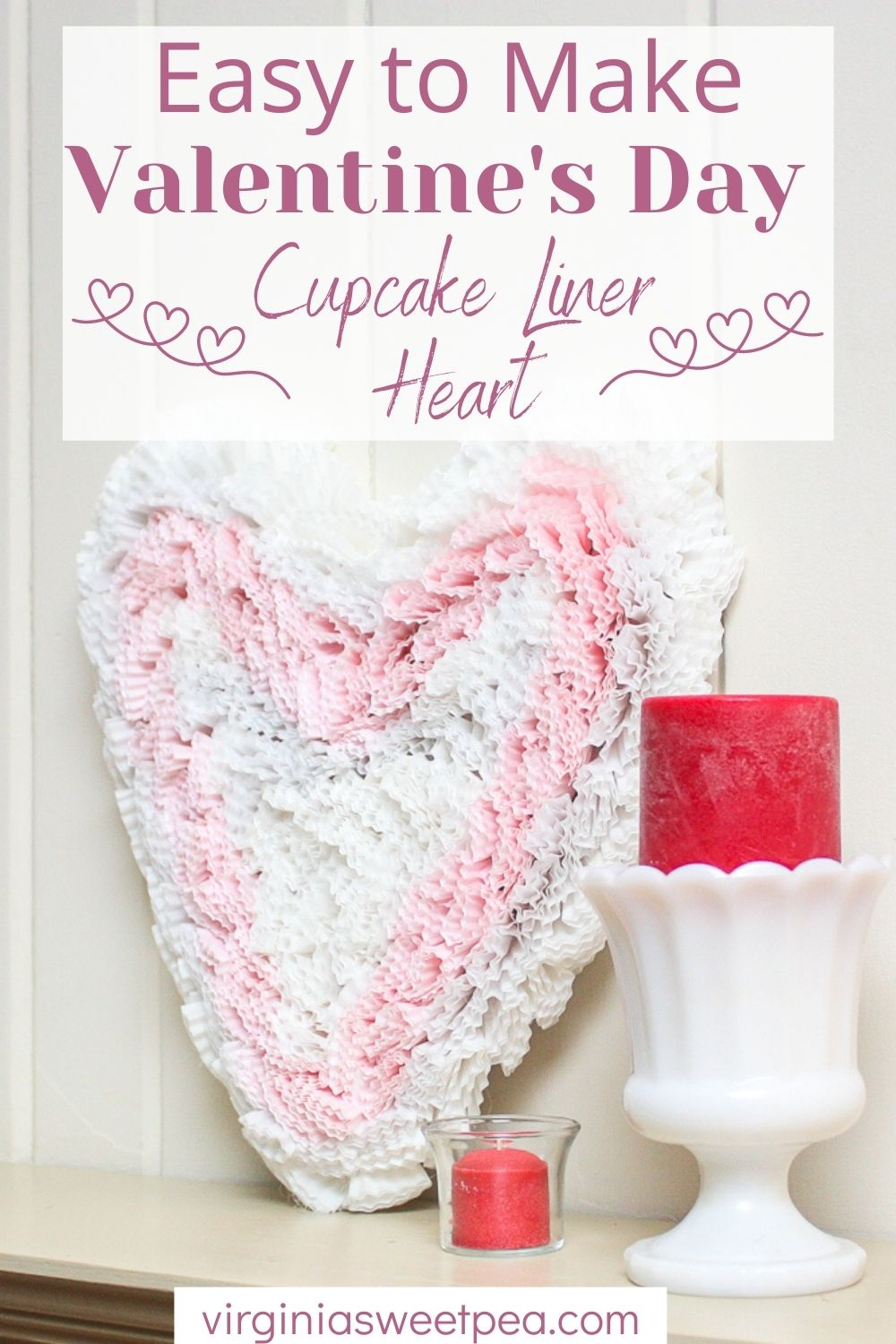Heart cut from cardboard and decorated with pink and white cupcake liners