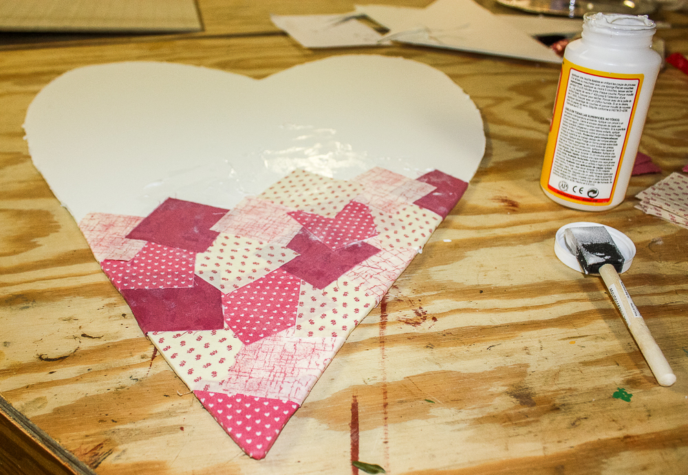 "2.5"" fabric squares Mod Podged to a foam core heart."