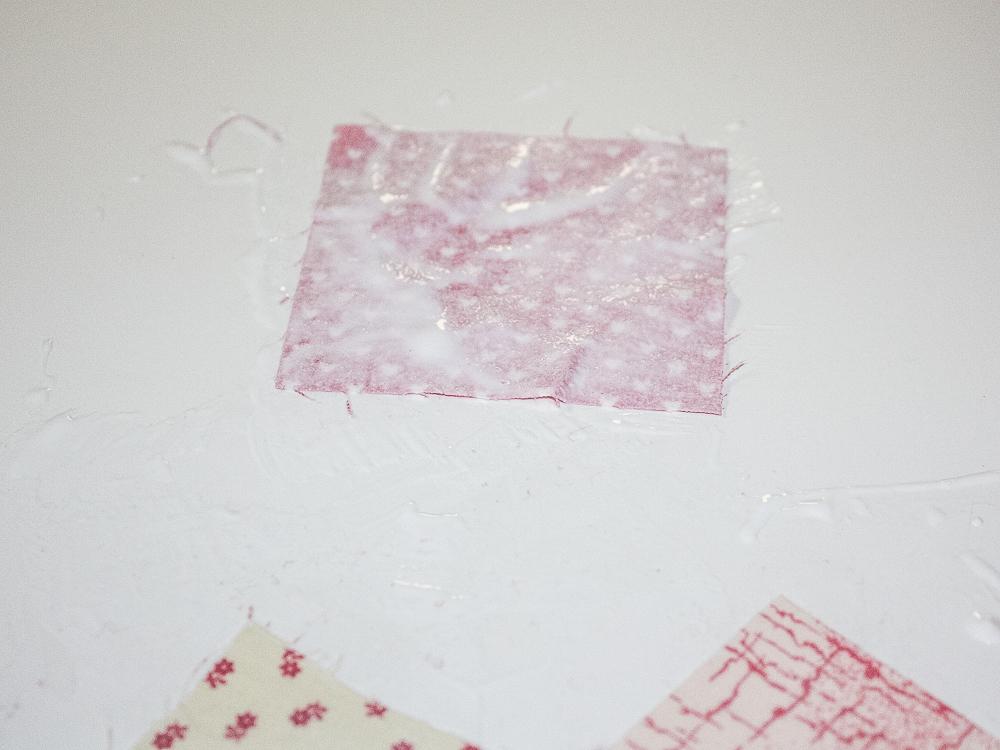Mod Podge brushed onto a fabric square