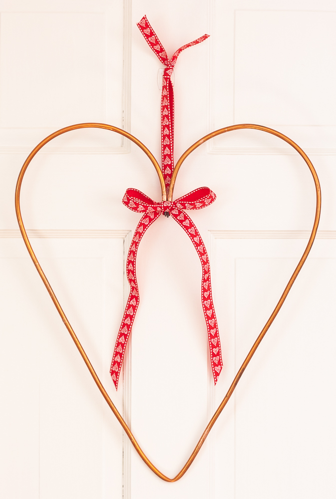 "Heart shaped wreath made using an upcycled 1/4"" copper refrigerator water line"