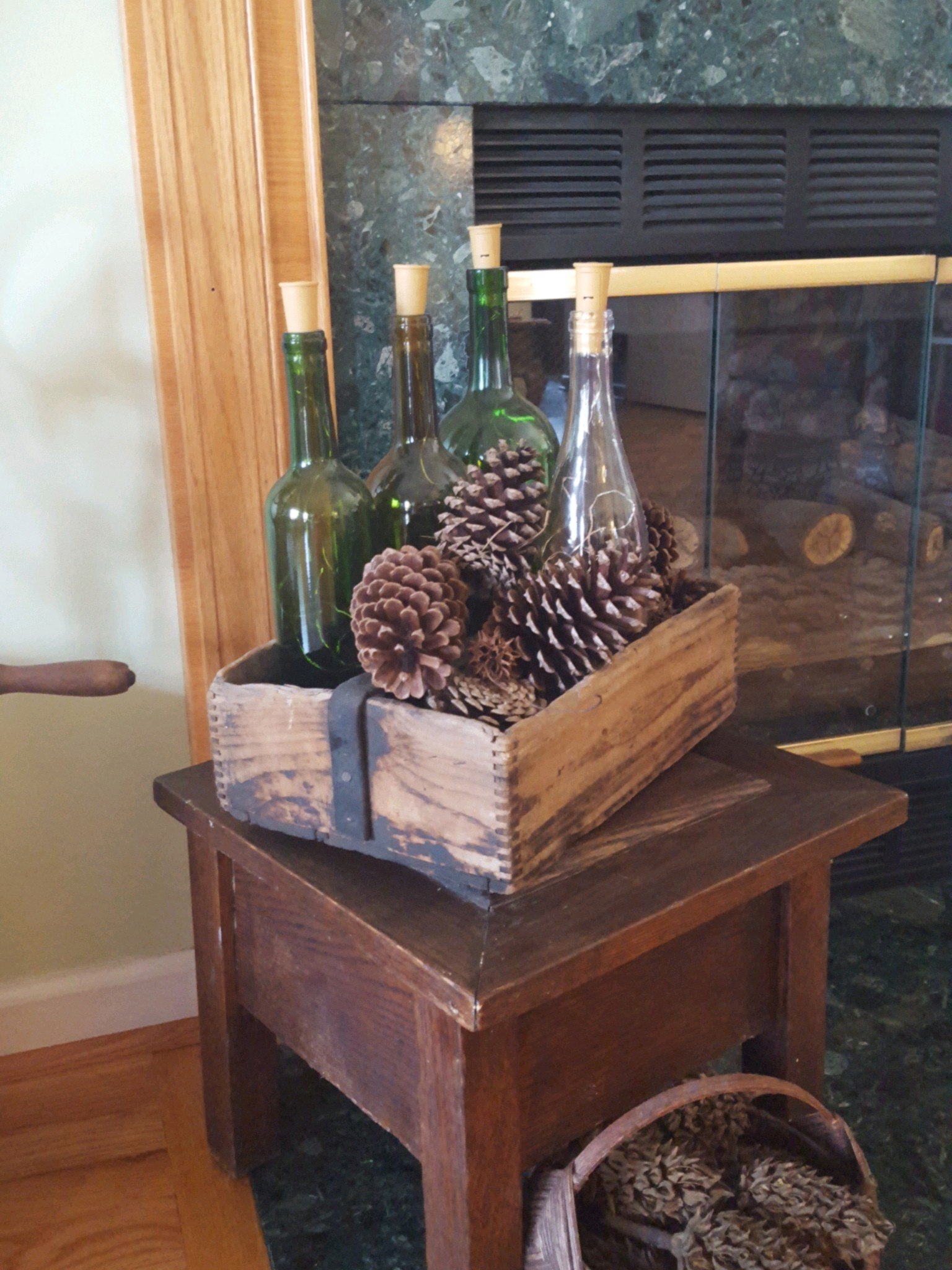 Vintage Toolbox decorated with wine bottles and pinecones