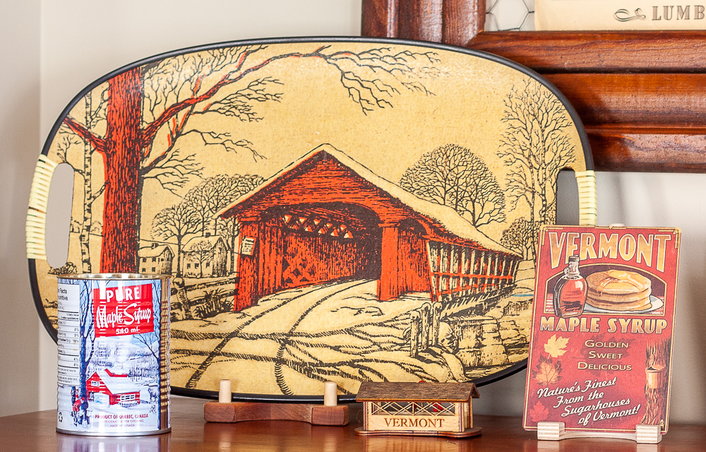 Vintage covered bridge tray, Vermont covered bridge Christmas ornament, and Vermont maple syrup postcard.