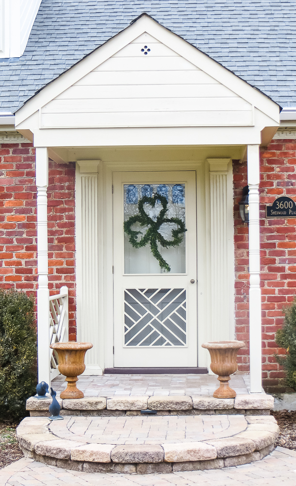 Front Door Decorated with a Boxwood clover wreath